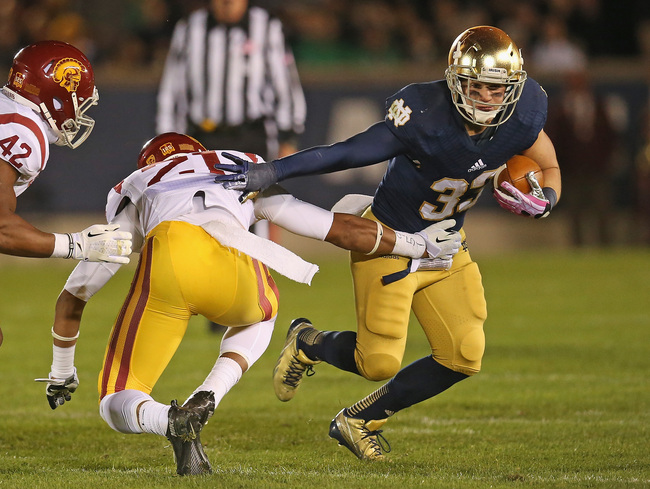 Hi-res-185373502-cam-mcdaniel-of-the-notre-dame-fighting-irish-breaks-a_crop_650
