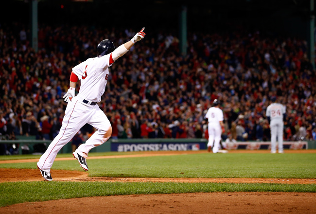 Hi-res-185379614-shane-victorino-of-the-boston-red-sox-celebrates-after_crop_650x440