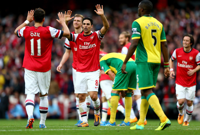 Hi-res-185349068-mesut-oezil-of-arsenal-celebrates-with-mikel-arteta-as_crop_650x440