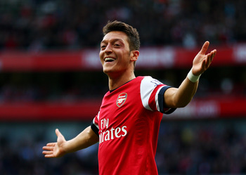 Hi-res-185347583-mesut-oezil-of-arsenal-celebrates-as-he-scores-their_display_image