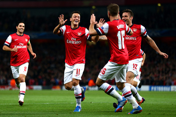 Hi-res-182601459-mesut-oezil-arsenal-is-congratulated-by-teammate-aaron_display_image