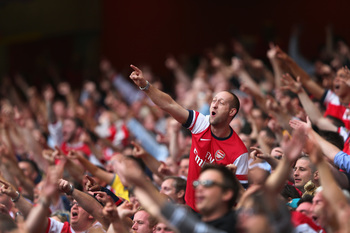Hi-res-179195751-arsenal-fans-celebrate-victory-after-the-barclays_display_image