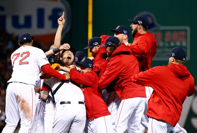 Hi-res-185382038-junichi-tazawa-of-the-boston-red-sox-celebrates-with_crop_650x440