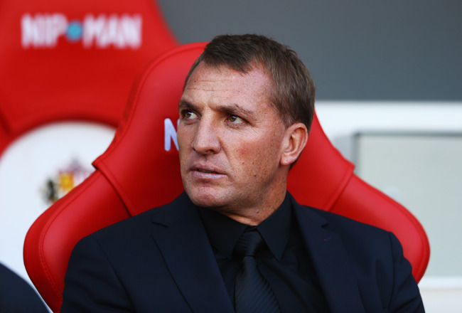 Hi-res-182285304-brendan-rodgers-manager-of-liverpool-looks-on-during_crop_650