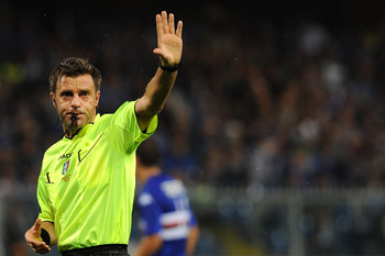 Hi-res-181160493-referee-nicola-rizzoli-signals-a-foul-during-the-serie_display_image