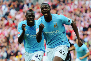 Hi-res-114175930-yaya-toure-of-manchester-city-celebrates-with-mario_display_image