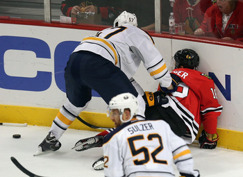 Hi-res-184245744-tyler-myers-of-the-buffalo-sabres-shoves-marcus-kruger_display_image