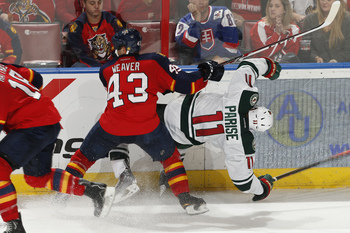 Hi-res-185374195-zach-parise-of-the-minnesota-wild-is-checked-into-the_display_image