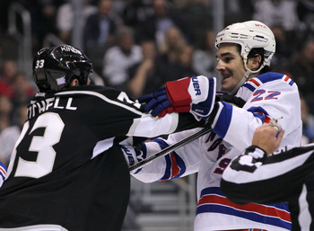 Hi-res-183609212-willie-mitchell-of-the-los-angeles-kings-pushes-at_display_image