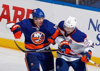 Hi-res-185151270-travis-hamonic-of-the-new-york-islanders-gets-tangled_display_image