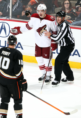 Hi-res-185339998-zbynek-michalek-of-the-phoenix-coyotes-is-held-back-by_display_image