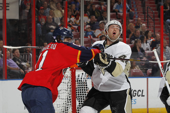 Hi-res-184156501-jonathan-huberdeau-of-the-florida-panthers-cross-checks_display_image