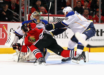 Hi-res-185159452-jay-bouwmeester-of-the-st-louis-blues-shoves-andrew_display_image