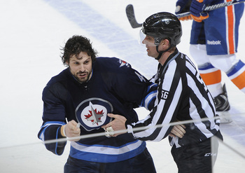 Hi-res-167548584-zach-bogosian-of-the-winnipeg-jets-gets-held-back-by_display_image