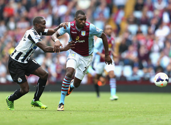 Hi-res-180533933-christian-benteke-of-aston-villa-tangles-with-mapou_display_image