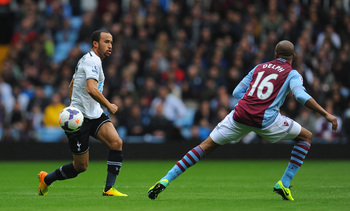 Hi-res-185412637-spurs-player-andros-townsend-gets-past-fabian-delph-of_display_image