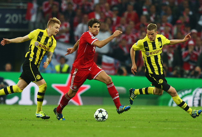Hi-res-169508866-javi-martinez-of-bayern-muenchen-goes-between-marco_crop_650x440