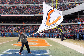 Hi-res-108198698-member-of-the-on-field-team-waves-a-bears-fan-during_display_image