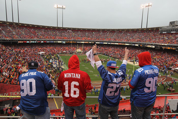 Hi-res-137569021-football-fans-cheer-before-the-start-of-the-nfc_display_image