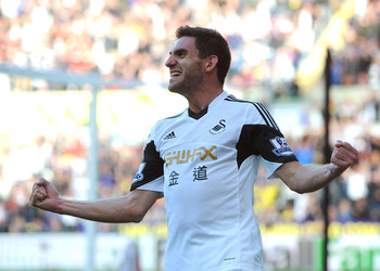 Hi-res-185347611-angel-rangel-of-swansea-city-celebrates-his-goal-during_display_image