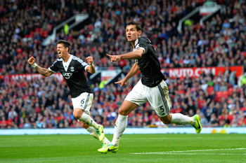 Hi-res-185349160-dejan-lovren-of-southampton-celebrates-with-teammate_display_image