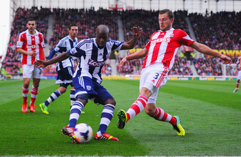 Hi-res-185349066-youssuf-mulumbu-of-west-brom-and-erik-pieters-of-stoke_display_image