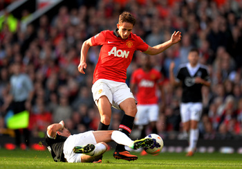 Hi-res-185347234-adnan-januzaj-of-manchester-united-is-tackled-by-morgan_display_image