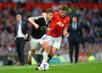Hi-res-185349557-adam-lallana-of-southampton-is-challenged-by-michael_display_image