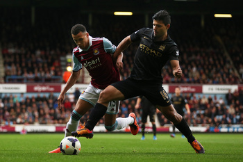 Hi-res-185350324-ravel-morrison-of-west-ham-is-tackled-by-sergio-aguero_display_image