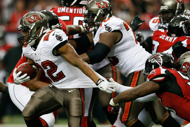 Hi-res-185422093-doug-martin-of-the-tampa-bay-buccaneers-rushes-past_crop_650