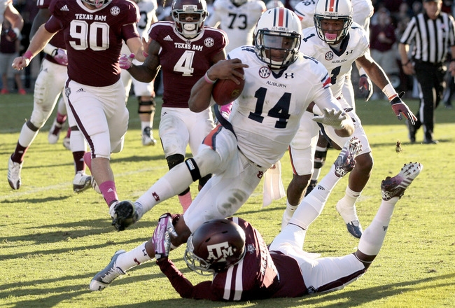 Hi-res-185369450-nick-marshall-of-the-auburn-tigers-rushes-for-a_crop_650x440