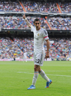 Hi-res-185359428-angel-di-maria-of-real-madrid-cf-signals-to-a-teammate_display_image