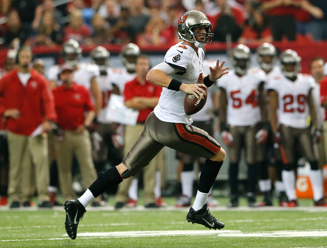 Hi-res-185430120-mike-glennon-of-the-tampa-bay-buccaneers-rolls-out-of_crop_650
