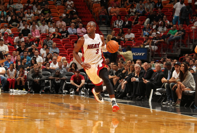 Hi-res-185383130-dwyane-wade-of-the-miami-heat-brings-the-ball-up-the_crop_650x440