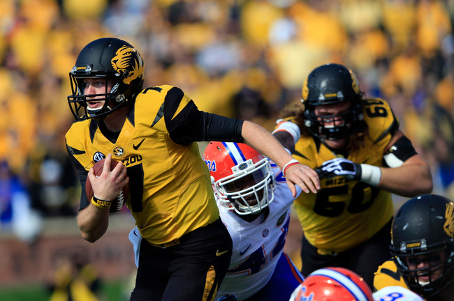 Hi-res-185354976-quarterback-maty-mauk-of-the-missouri-tigers-carries_crop_650