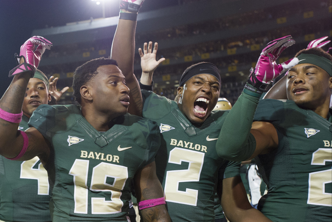 Hi-res-185377164-the-baylor-bears-celebrate-after-defeating-the-iowa_crop_650