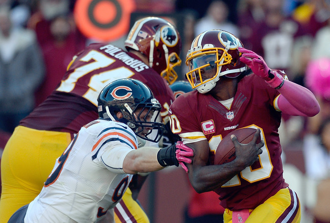 Hi-res-185430240-robert-griffin-iii-of-the-washington-redskins-avoids_crop_650x440