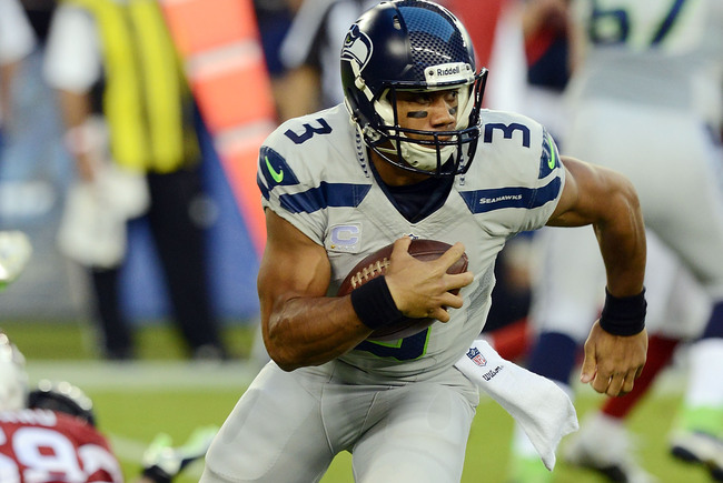 Hi-res-185155980-russell-wilson-of-seattle-seahawks-runs-with-the-ball_crop_650