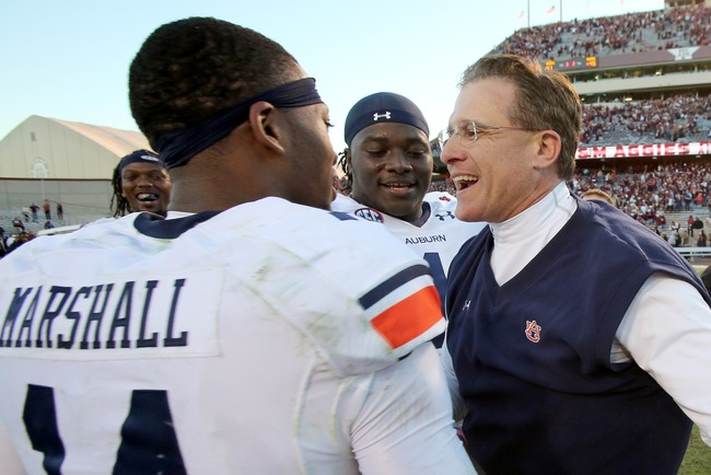 Hi-res-185369460-nick-marshall-of-the-auburn-tigers-hugs-head-coach-gus_crop_650