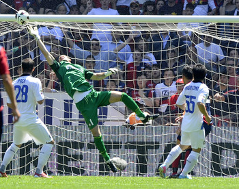 Samir Handanovic tips a shot over in Inter's penultimate game of 2012-13 against Genoa.