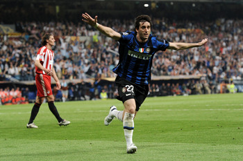 Diego Milito celebrates his brace in the 2010 UEFA Champions League final against Bayern.