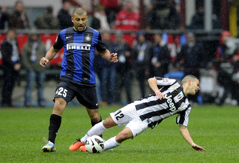 Walter Samuel challenges Juventus' Sebastian Giovinco in March.