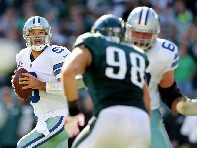 Hi-res-185435238-tony-romo-of-the-dallas-cowboys-looks-to-pass-in-the_crop_650
