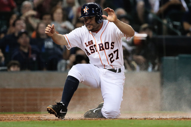 Hi-res-182254861-jose-altuve-of-the-houston-astros-scores-a-run-in-the_crop_650