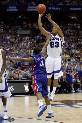 Hi-res-80736700-derrick-rose-of-the-memphis-tigers-shoots-over-sherron_display_image