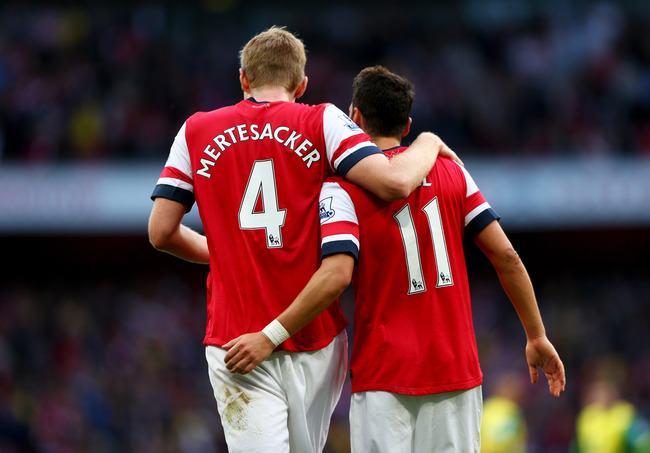 Hi-res-185349604-per-mertesacker-and-mesut-oezil-of-arsenal-celebrate_crop_650