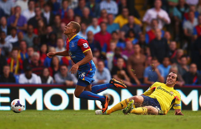Hi-res-178936775-dwight-gayle-of-crystal-palace-is-brought-down-in-the_crop_650