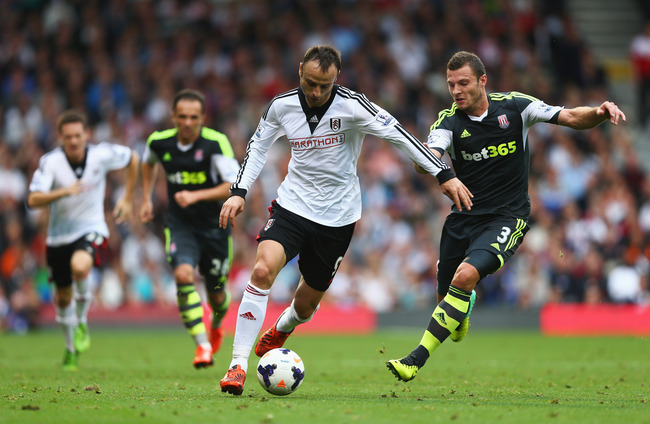 Hi-res-183154097-dimitar-berbatov-of-fulham-takes-on-erik-pieters-of_crop_650