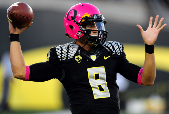 Hi-res-185373919-quarterback-marcus-mariota-of-the-oregon-ducks-wears-a_crop_650x440