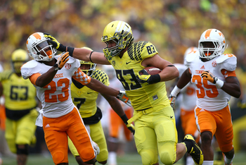 Hi-res-181172955-johnny-mundt-of-the-oregon-ducks-gives-a-stiff-arm-to_display_image